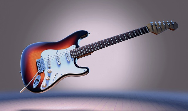 להתקין מיתרים בגיטרה חשמלית